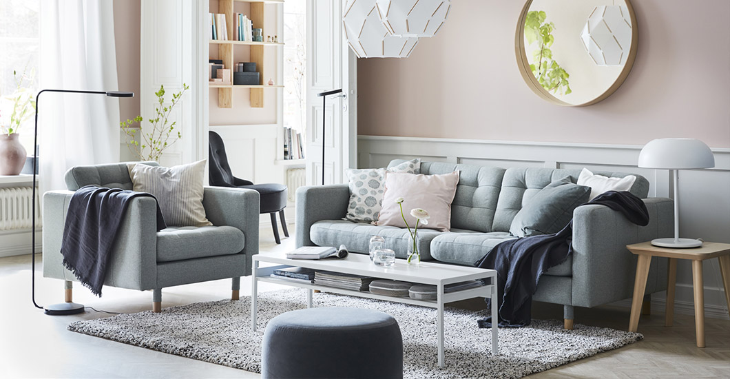 Make a living room more peaceful with LANDSKRONA light green sofa and sectionals, SJÖPENNA pendant lamps and functional YPPERLIG lighting.