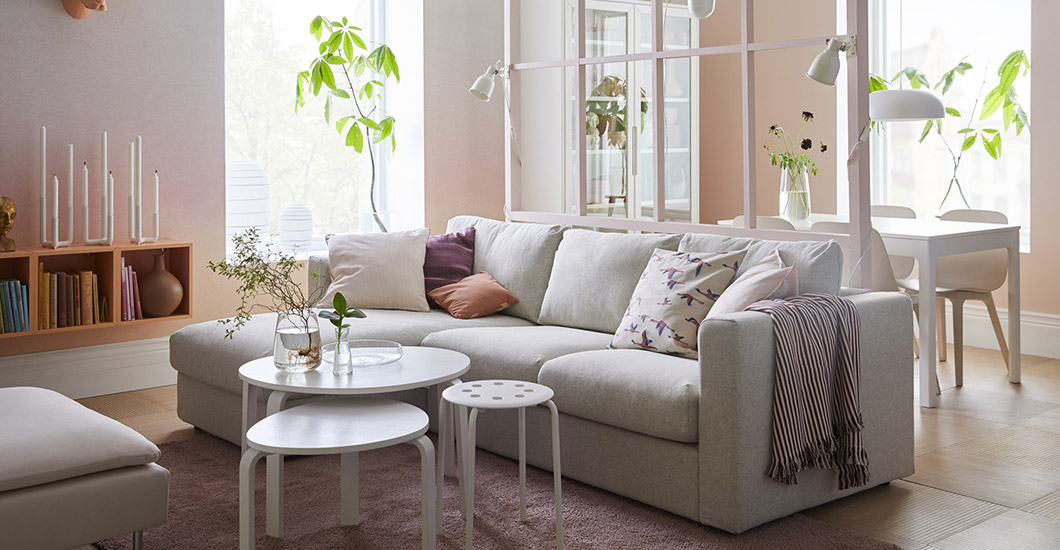 A Pink And White Living Room With Beige Sofa Chaise Longues The Hint Of