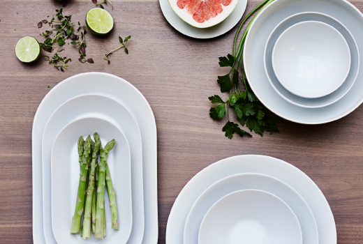 IKEA 365+ dinnerware, including plates and bowls, all made of white porcelain.
