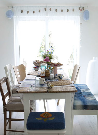 create a natural and relaxed dining room table with mix of handmade