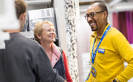 Man helping the elderly in an IKEA store.