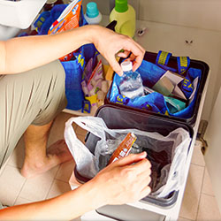 Marcus has a pull-out system tucked under the sink: one bin is for disposable waste, and the other is for all bottles, cardboard, cans that can be recycled.