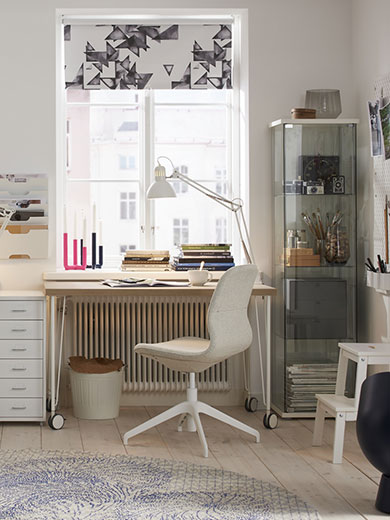 A beige and white home office in a neutral coloured sitting room environment.