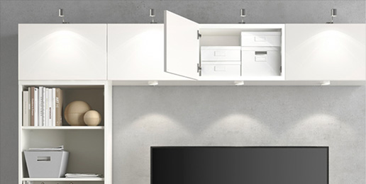 ikea besta tv media unit showcasing overhead storage and integrated lighting possibiliteis