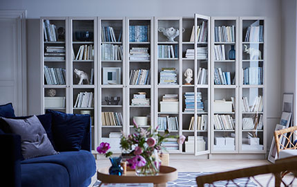 White shelving units with glass doors.