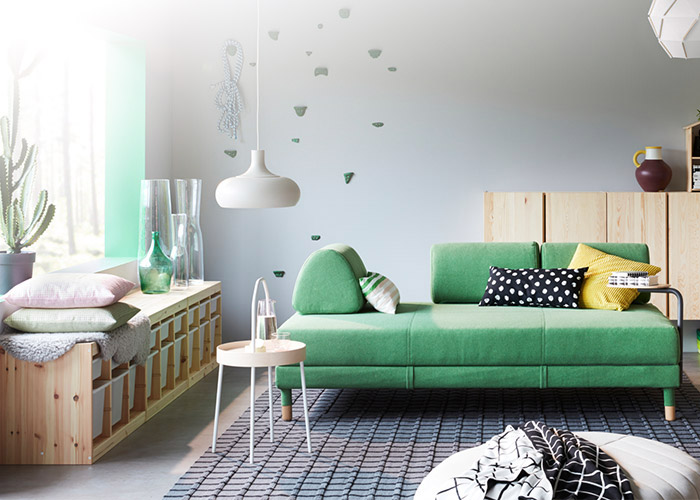 Our FLOTTEBO modular sofa-bed in green displayed in a bright, clean living room.