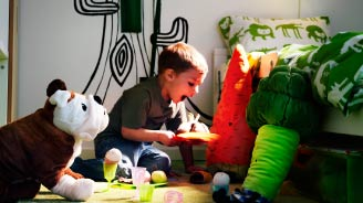 boy playing with IKEA soft toys