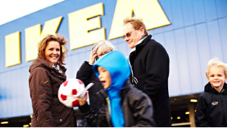 a family in front of an IKEA store
