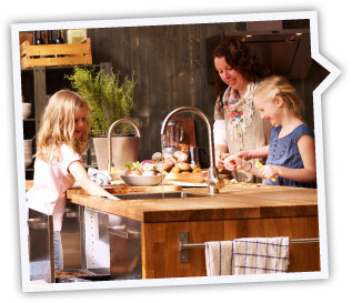 woman and children in IKEA kitchen