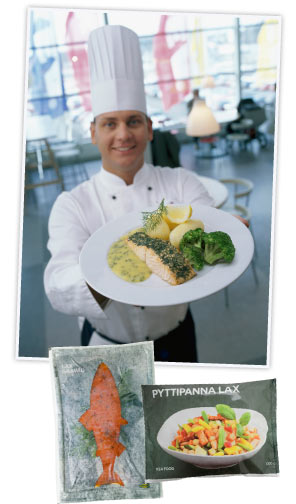 a chef in an IKEA restaurant holding up a salmon dish
