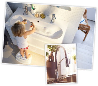 child playing in a washbasin