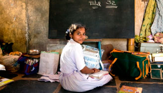 young student sitting on floor in classroom