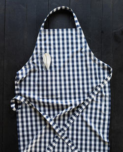 A handmade dark blue checkered apron.