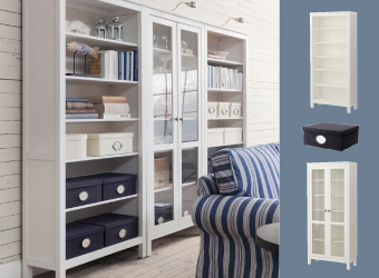 White-stained wood HEMNES bookcase with glass doors and KVARNVIK boxes in dark blue