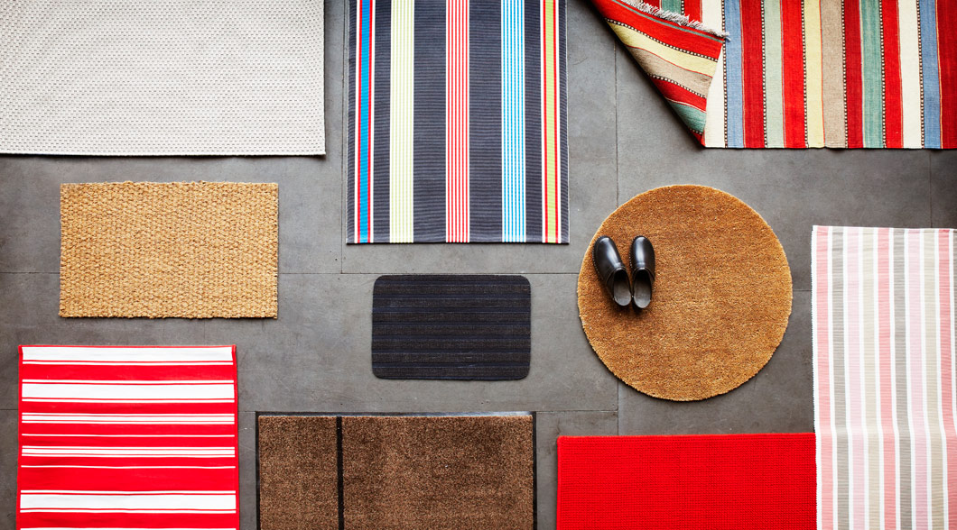 A reversible multicolour flatwoven rug and other rugs and mats.