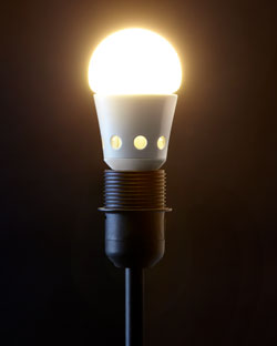 A lit LED bulb against a black background.