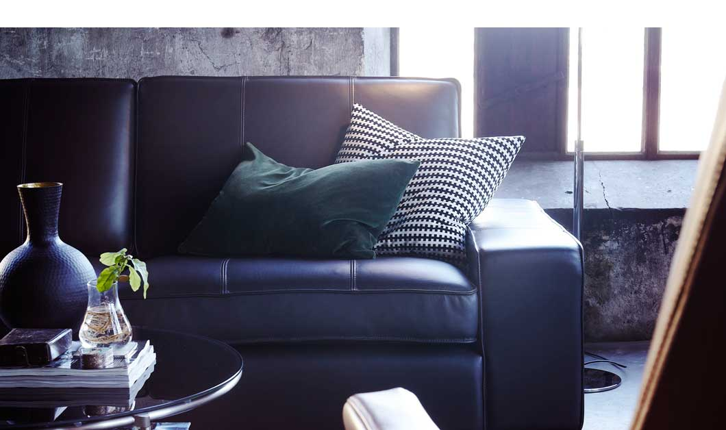 Black leather sofa made with hardwearing leather.