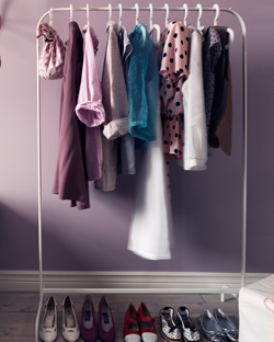 Dresses and shirts hang from MULIG clothes rack.