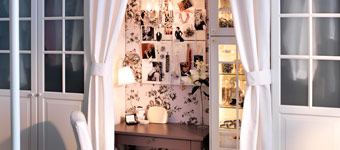 Turn a little nook into a hobby or workspace with a desk, some curtains, and fabric covered notice board.