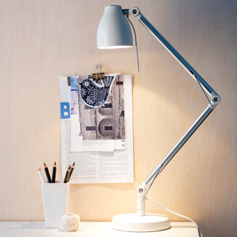TRÅL white work lamp with adjustable arm and head.