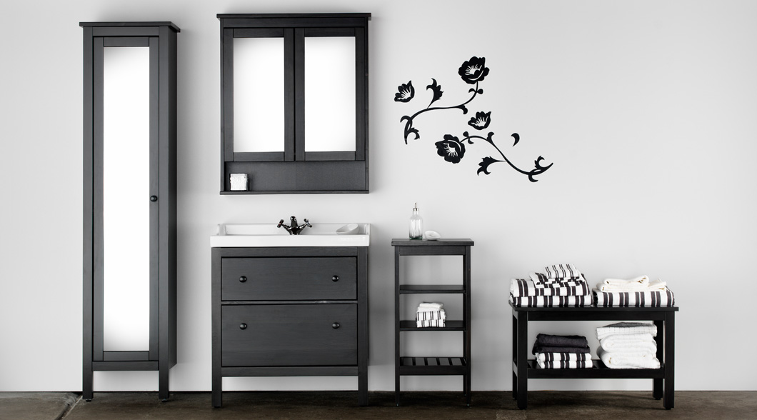 Water-resistant HEMNES bathroom furniture in black brown.