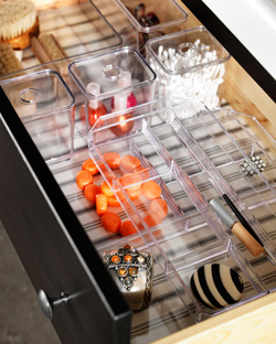 Clear drawer inserts with lids, in various sizes.