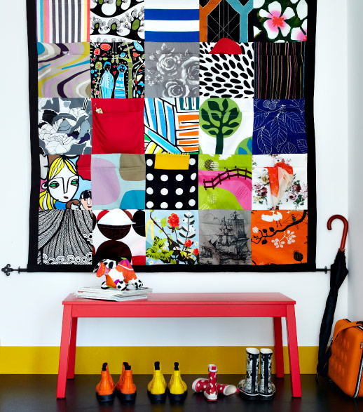 A hanging patchwork pocket quilt, handmade with IKEA fabrics.