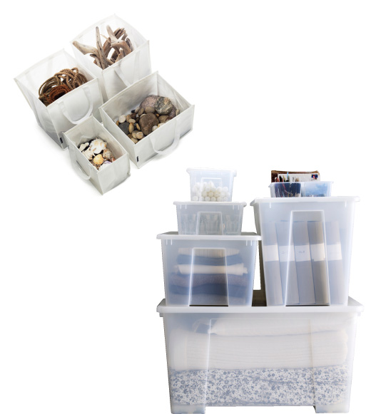 Plastic SAMLA storage boxes, stackedand filled with linens.