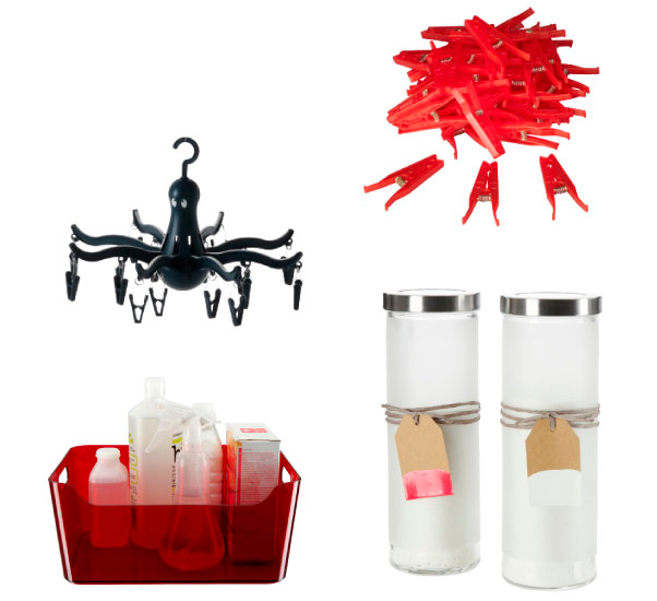 Red clothes pegs, black PRESSA hanging dryer, DROPPAR glass jars and a red box with washing products