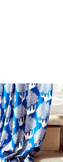 Blue and white KAJSAMIA panel curtains used as a room divider.
