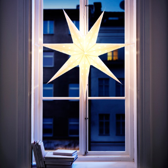 STRÅLA star light decorating a window