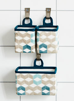 Fabric baskets hung on hooks