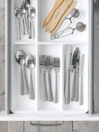 Cutlery organised in a drawer