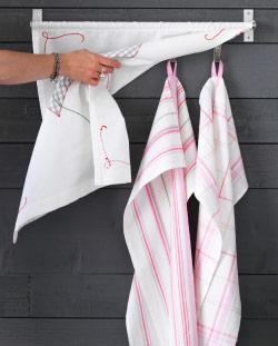 Tea towels hanging on a wall