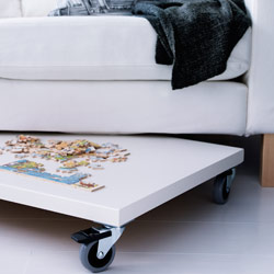 Sofa with board on castors.