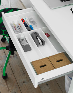 Close-up of desk drawer with desk accessories