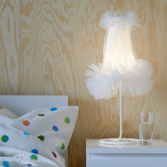 LED table lamp, inspired by a ballerina tutu, standing on a bedside table
