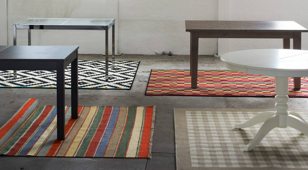 Dining tables in different designs with colourful rugs