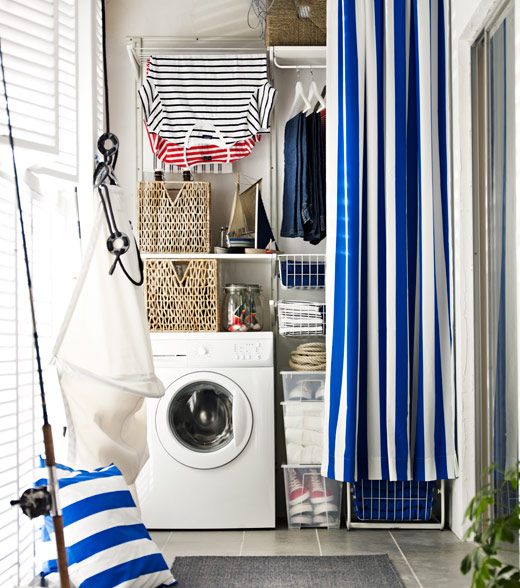 Laundry and storage hidden behind a drape