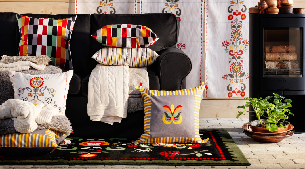 Room setting with cushion covers, fabrics and rugs with Swedish folklore patterns