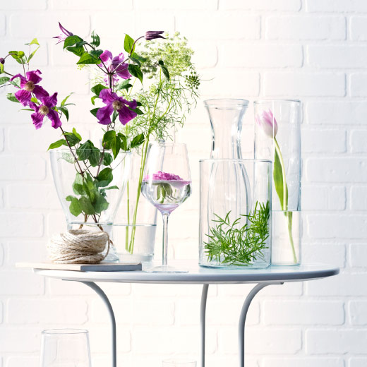 Clear glass vases in different shapes and sizes with flowers
