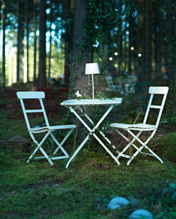 White MÄLARÖ table and chairs in a woodland setting