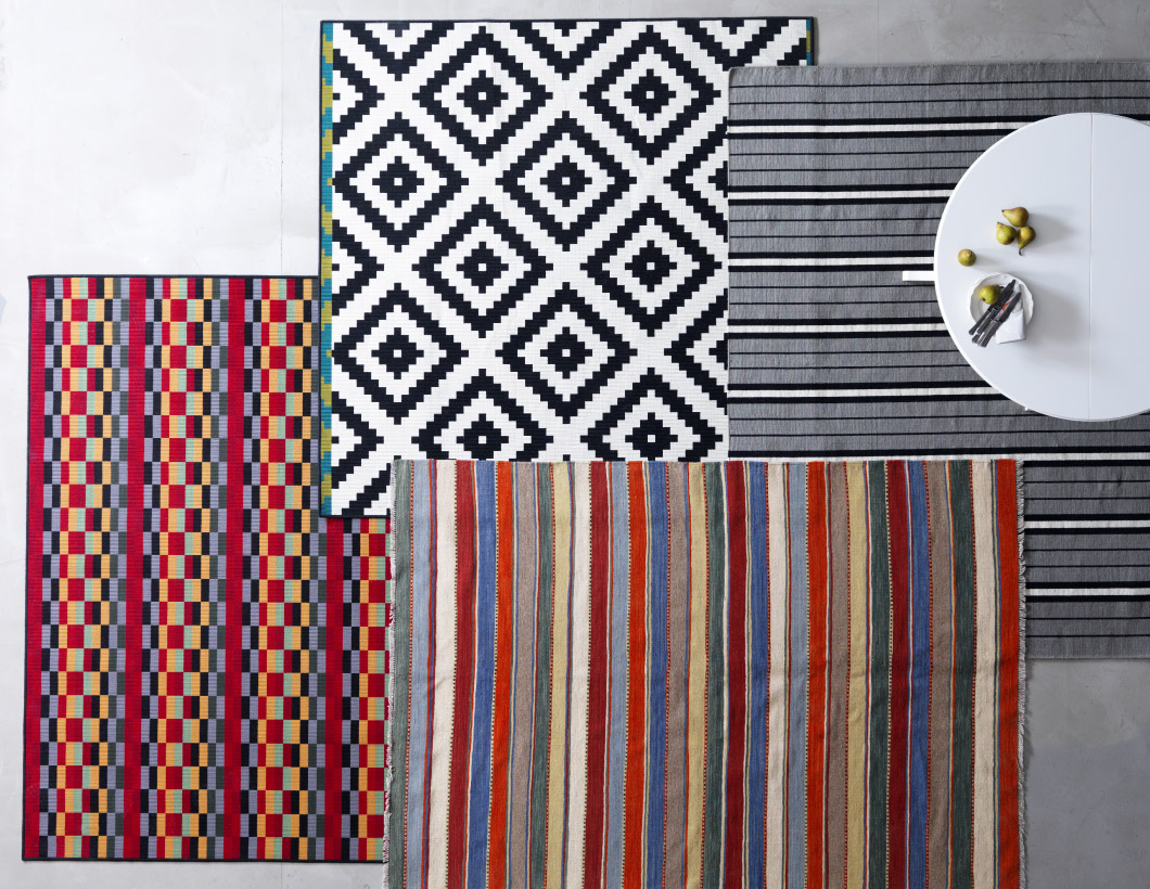 Mix of rugs in different colours and sizes