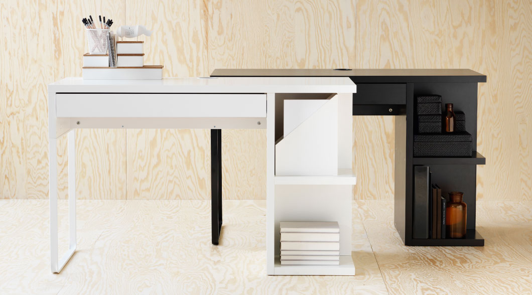 White and black MICKE desks with integrated storage