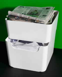 Two stacked plastic waste sorting bins with news papers and white papers