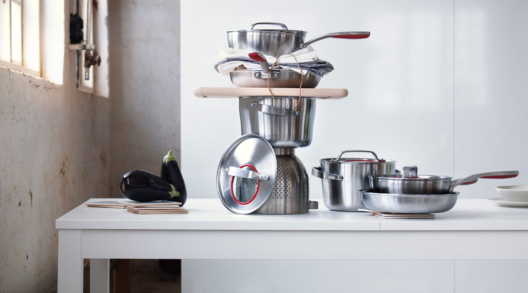 SENSUELL stainless steel cookware stacked on a table