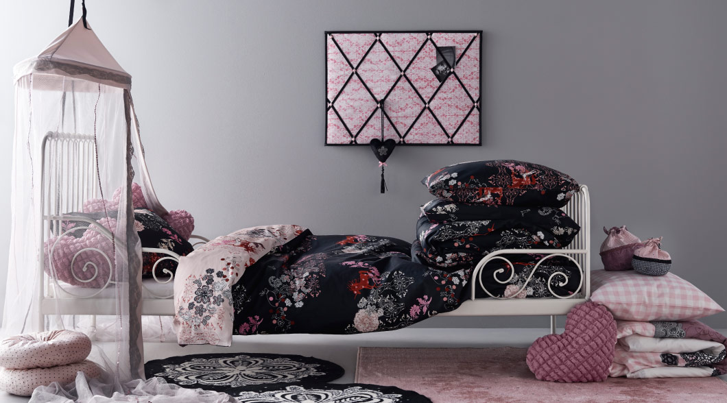 Assorted children's room accessories in pink, black and white