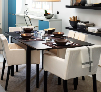 A table set for entertaining surrounded by comfy chairs