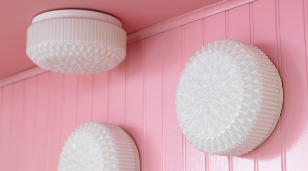 Three VANADIN white glass ceiling/wall lamps on a pink wall and ceiling