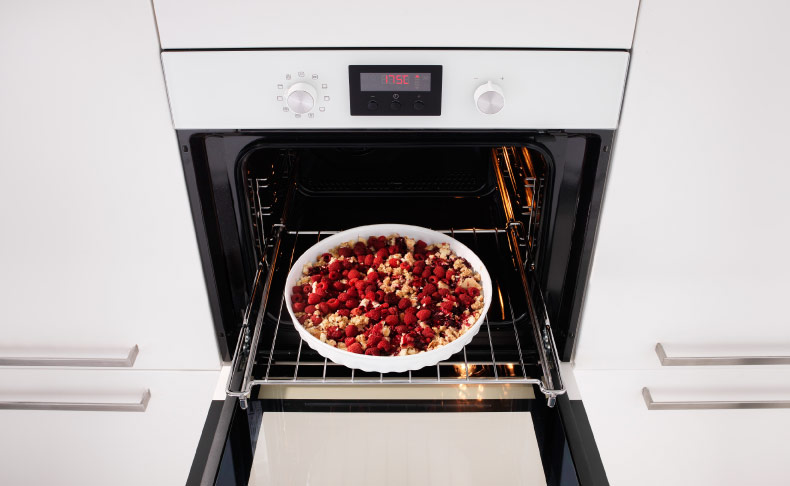 Built-in white forced air oven in a white kitchen